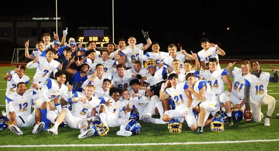 Aloha players bask in their 42-41 win at Jesuit on Friday night. (Photo by Hanna Plasker)