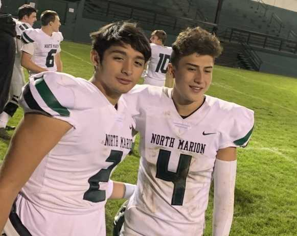 North Marion's Sergio Jimenez (2) and Tanner Saucedo (4) connected for a touchdown pass Thursday. (Photo by Lane Jensen)