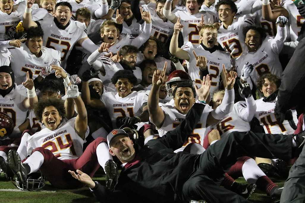 Coach Steve Pyne and the Central Catholic Rams celebrate Friday's win at Clackamas. (Photo by Jim Nagae)