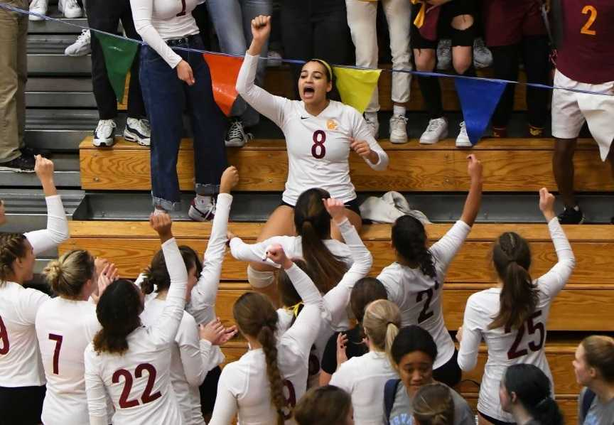 Marianna Payne (8) and Central Catholic celebrate a semifinal win. (Photo by Ed McReynolds)