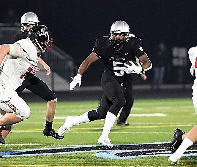 EJ Broussard rushed for a team-high 64 yards for Mountainside against Clackamas. (Photo byJon Olson)