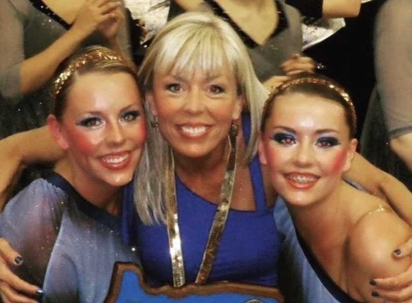 Robin Meier with her daughters, Lexi and Belle, celebrate winning the 2012 4A Large State Dance Championship.