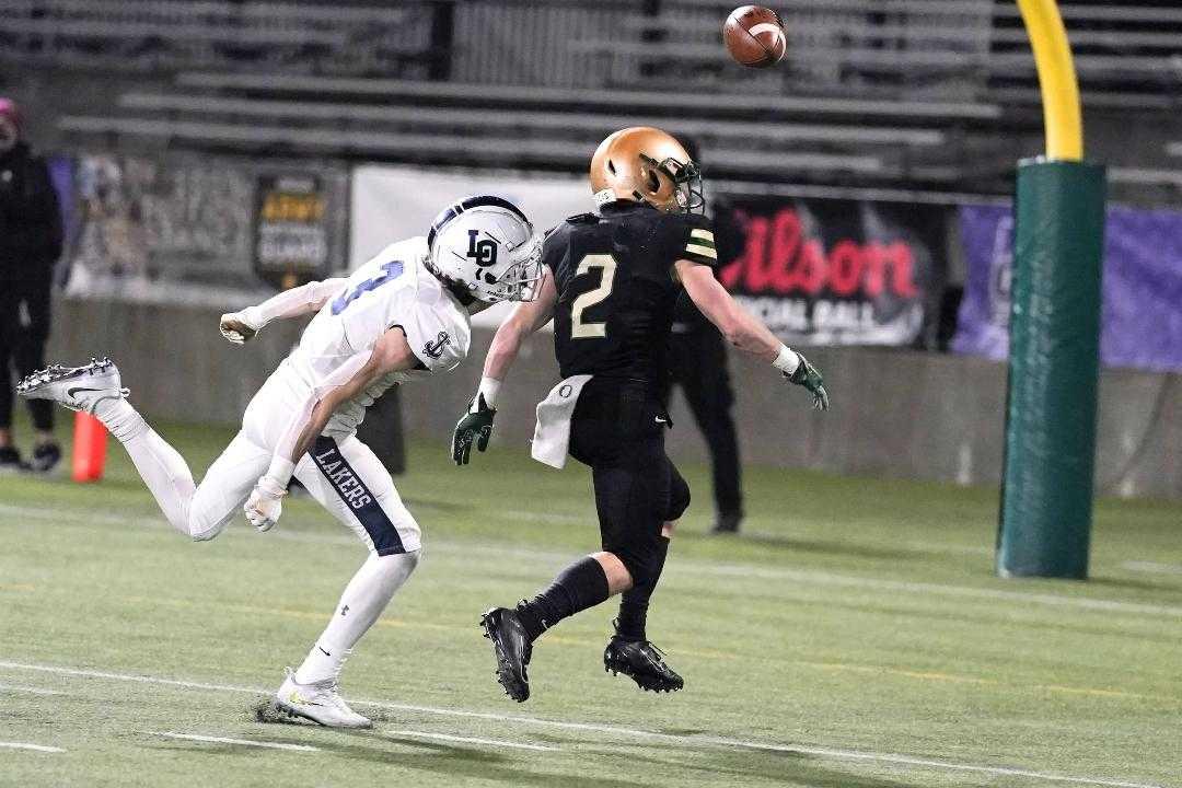 Lake Oswego's Joe Hutson (3) knocks the ball away from Jesuit's Kade Wisher in the fourth quarter Friday. (Photo by Jon Olson)
