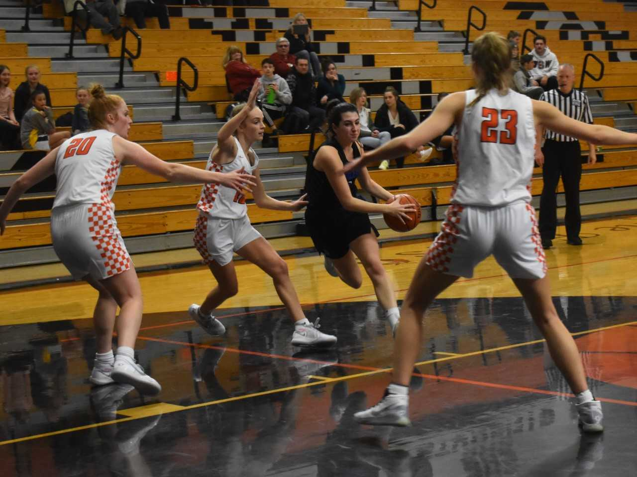 Silverton posts Riley Traeger (20) and Truitt Reilly (23) shut down Churchill drives Wednesday. (Photo by Jeremy McDonald)