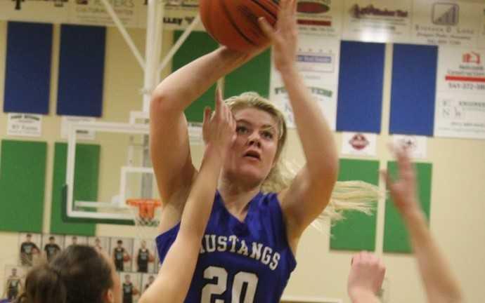 Riley Davis, a 6-foot-2 junior, scored 13 points in Crane's win Saturday. (John Braese/Eastern Oregon Sports Photos)