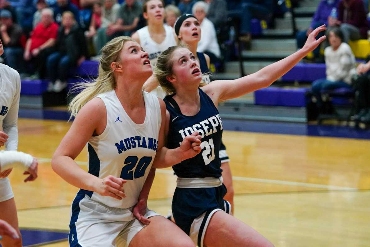 Crane's Riley Davis (20) battles for position with Joseph's Sabrina Albee. (Randy Seals/Eastern Oregon Sports Photos)