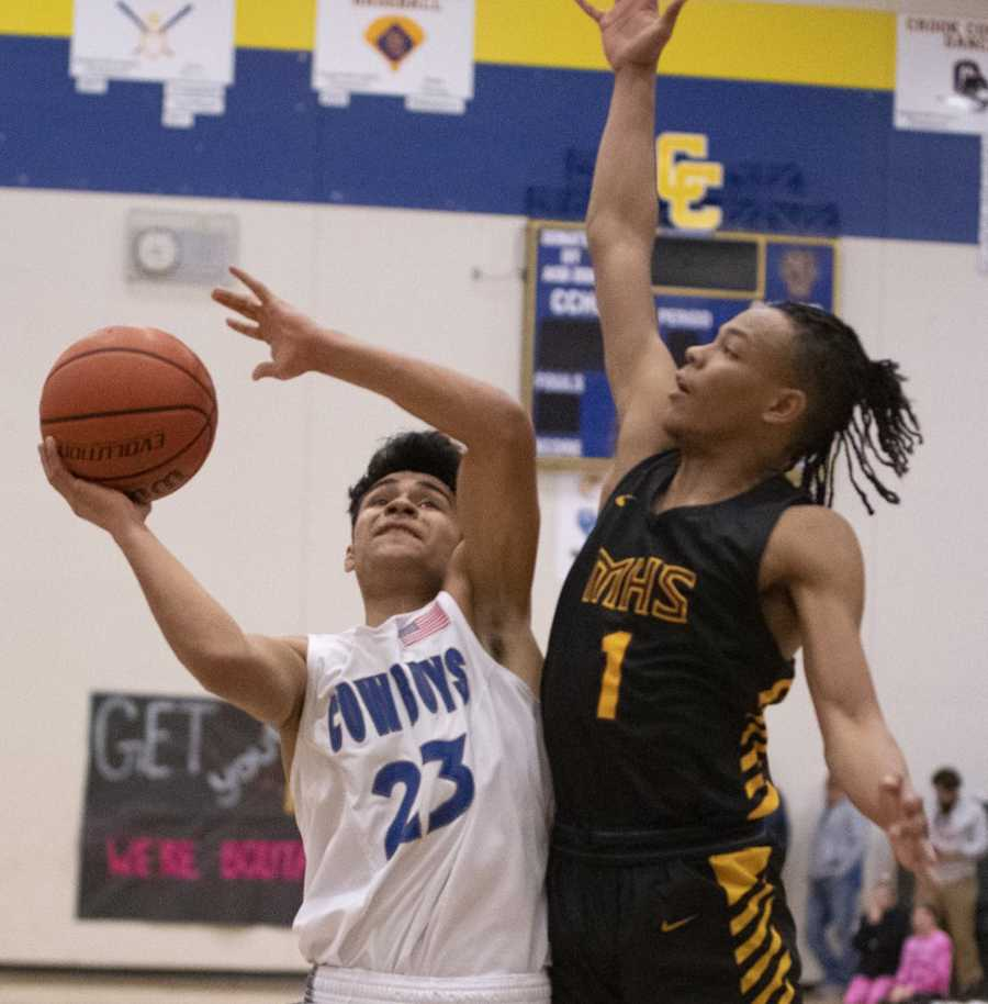Crook County's Kevin Sanchez works against Milwaukie's Keshawn Myles in Saturday's win. Photo by Lon Austin, Central Oregonian