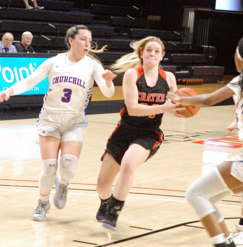 Allison Waters drives past Churchill's Sophie Elstone in the pivotal second quarter of Tuesday's game