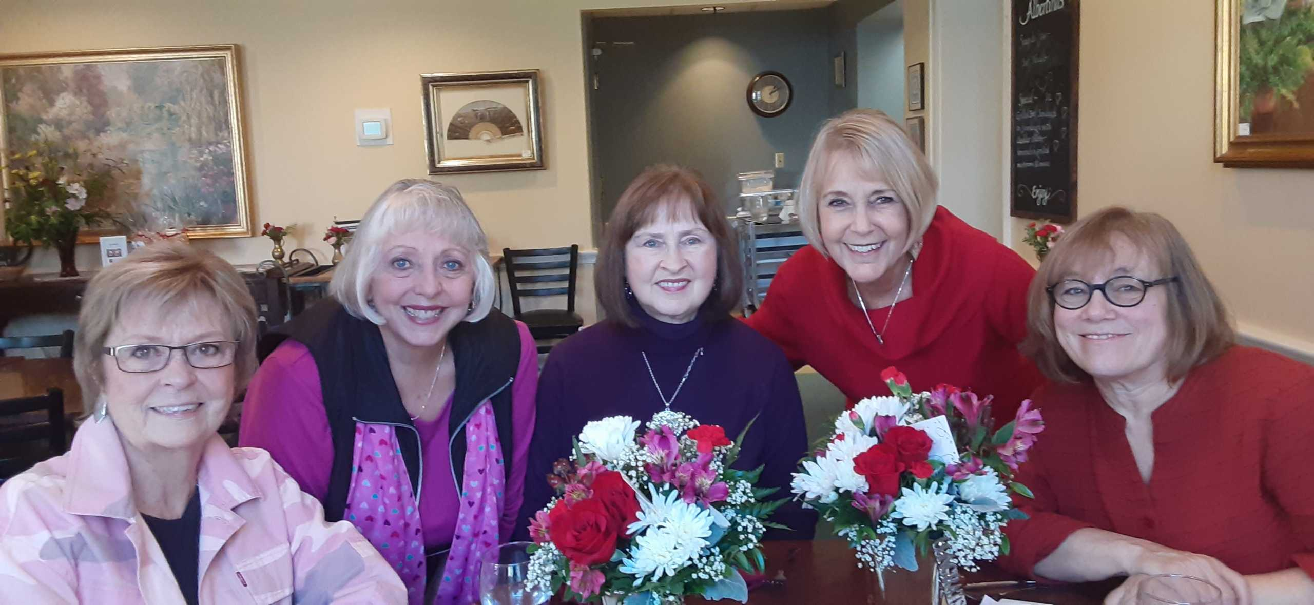 Karen Floyd (second from left) and Roe Ann Oberg (center) with past Lifetime Achievement honorees.