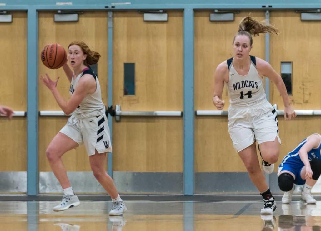 Sydney Burns (left) and Emilia Bishop (14) were first-team NWOC selections for Wilsonville last season. (Photo by Greg Artman)
