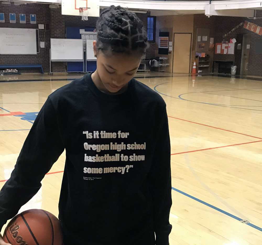 Sophomore Onna Brown wears the shooting shirt that reminds Benson of how far it has come as a program