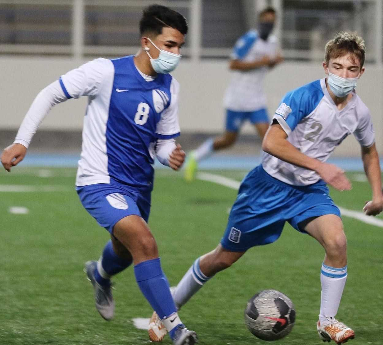 South Medford's Eloy Saucedo (8) works against pressure from Hidden Valley's Jake Saunders (2). (Photo by Tom Lavine)