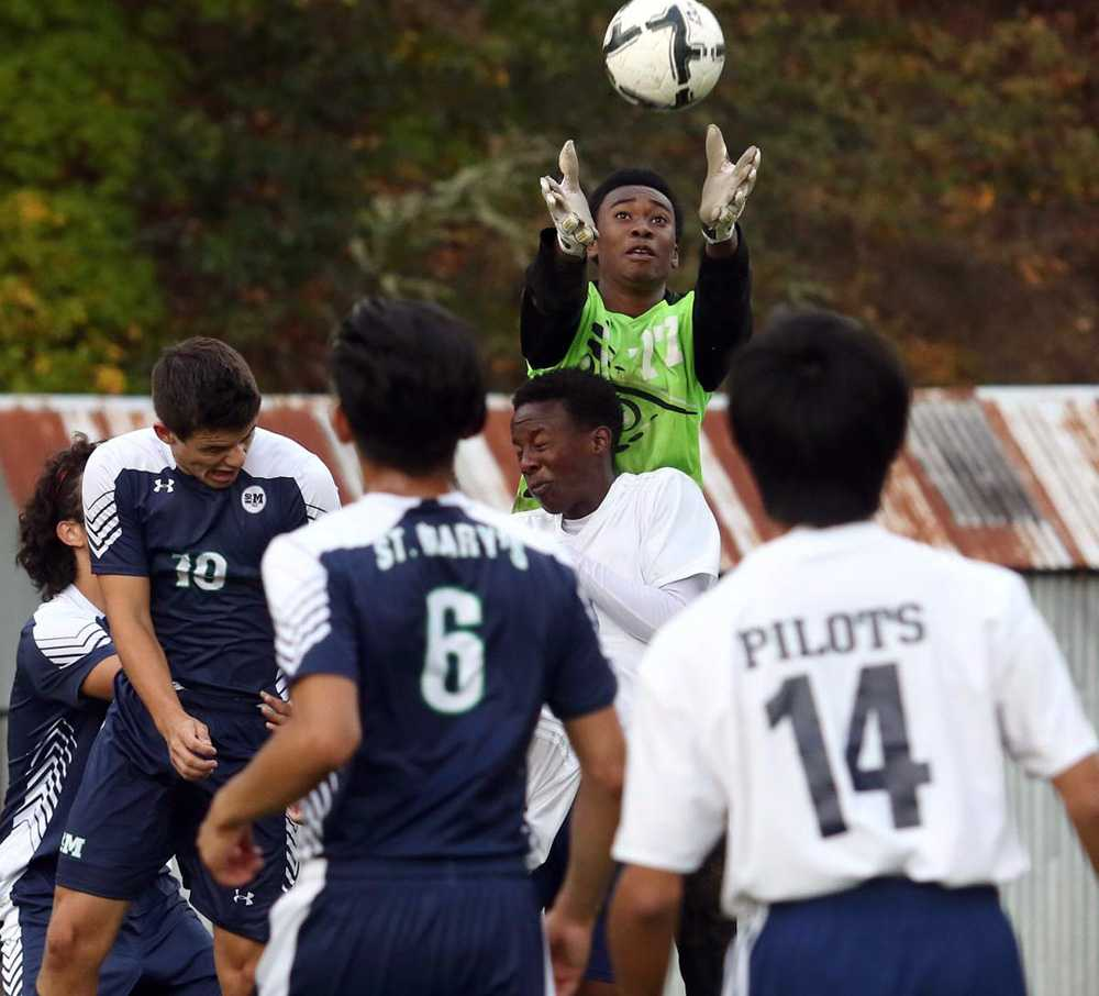 Lester (in green) hopes to play soccer or basketball at Lane CC next year. Photo courtesy of Michael Sullivan, News Review