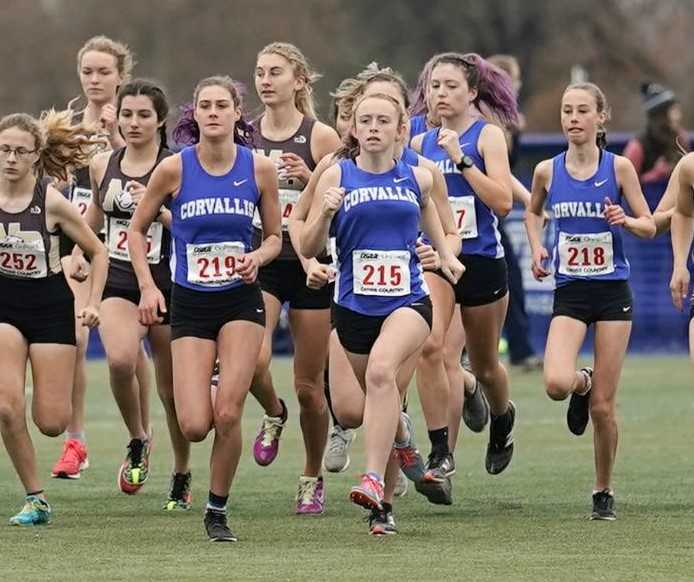 Madeline Nason (219) and Ava Betts (215) led the way for Corvallis at the 5A meet in 2019. (Photo by Jon Olson)