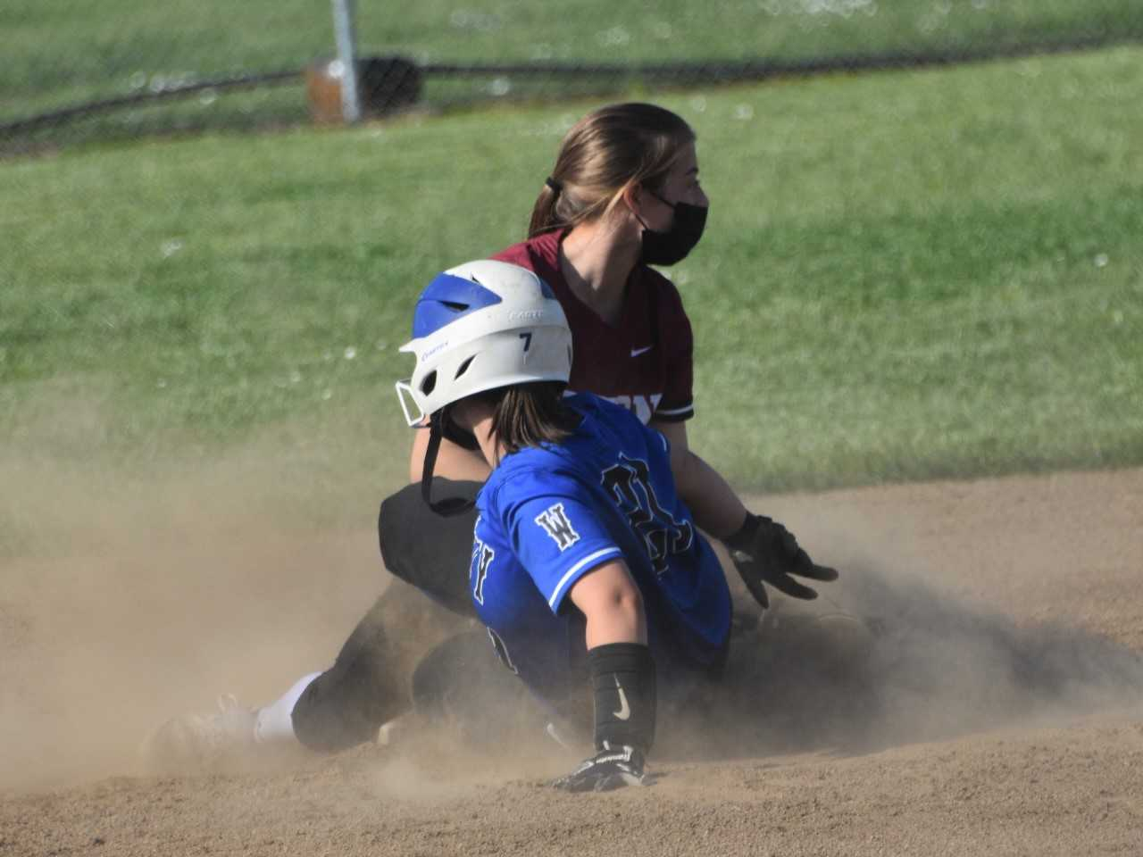Amity's McKenzie Turley slides into second base against Dayton's Lacey Smith on Tuesday. (Photo by Jeremy McDonald)