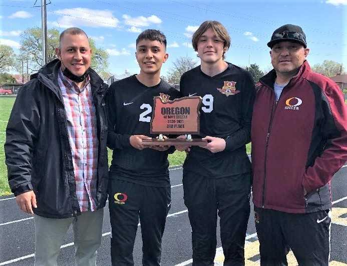 Ontario boys coach Jaime Gonzalez (left) with his son Jaime (2), nephew Jamis (9) and brother Javier, the school's girls coach.
