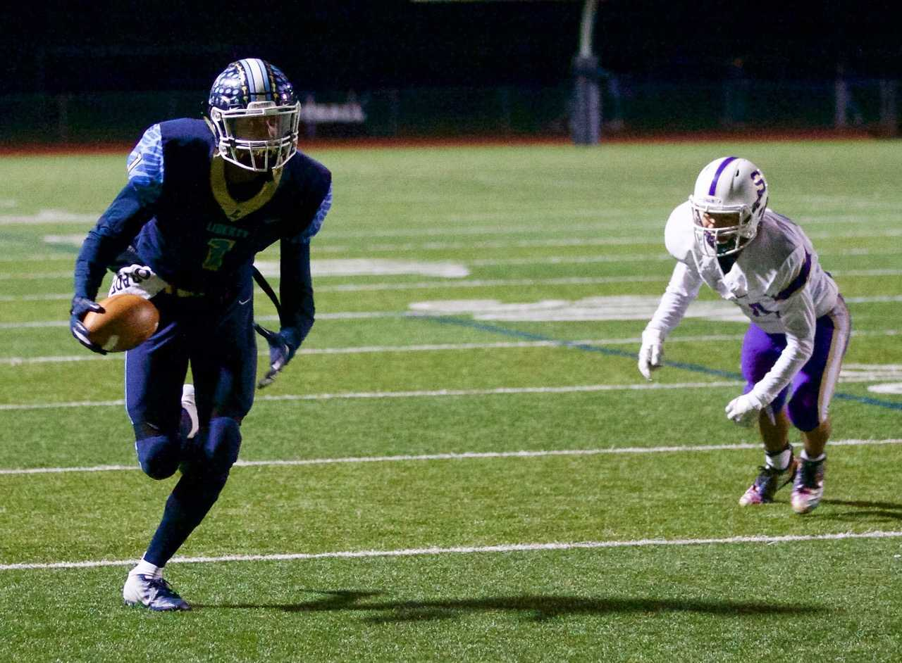 Liberty's Marquis Brown scored on a 21-yard touchdown pass in the second quarter Friday night. (Photo by Norm Maves Jr.)