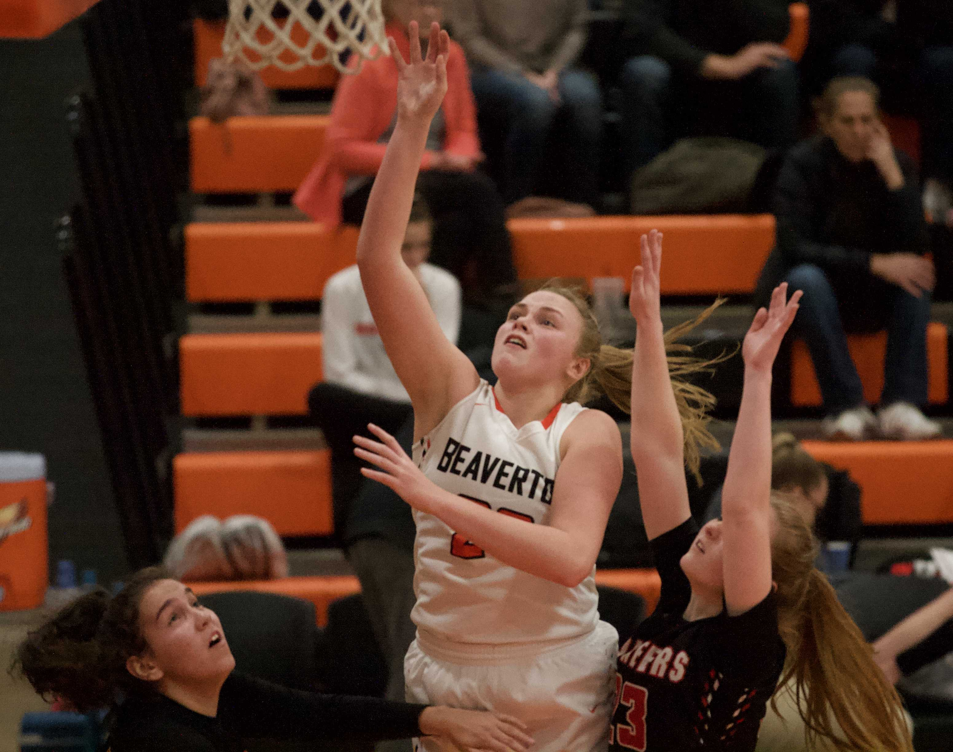Beaverton post Laura Erikstrup picks up two of her game-high 16 points against Oregon City. (Photo by Norm Maves Jr.)