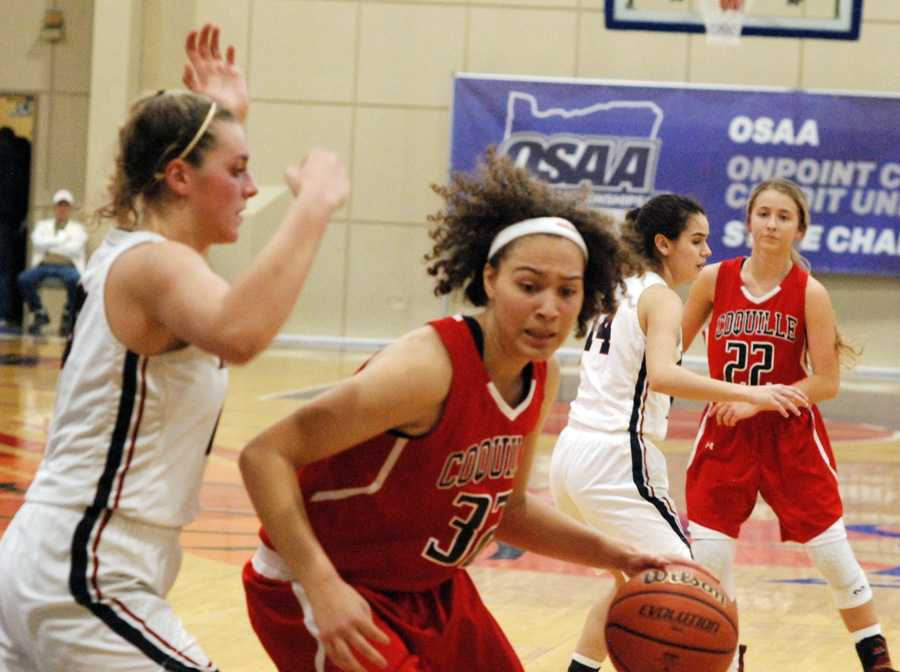 Coquille standout Morgan Baird works against Kenendy's Sophia Carley in the second half of an epic struggle.