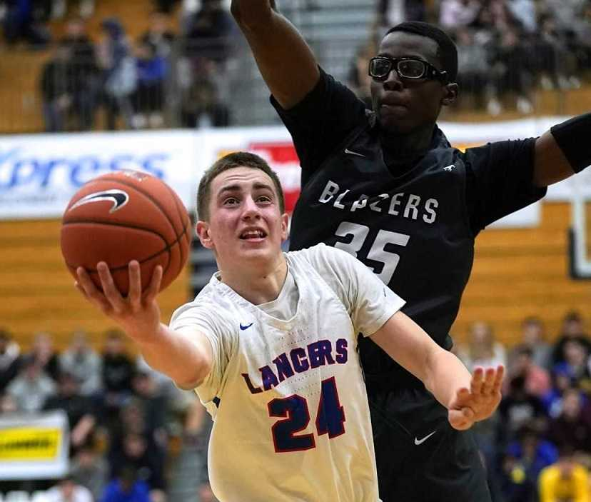Churchill's Brian Goracke (24), a transfer from 2A Monroe, is averaging 15 points per game. (Photo by Jon Olson)