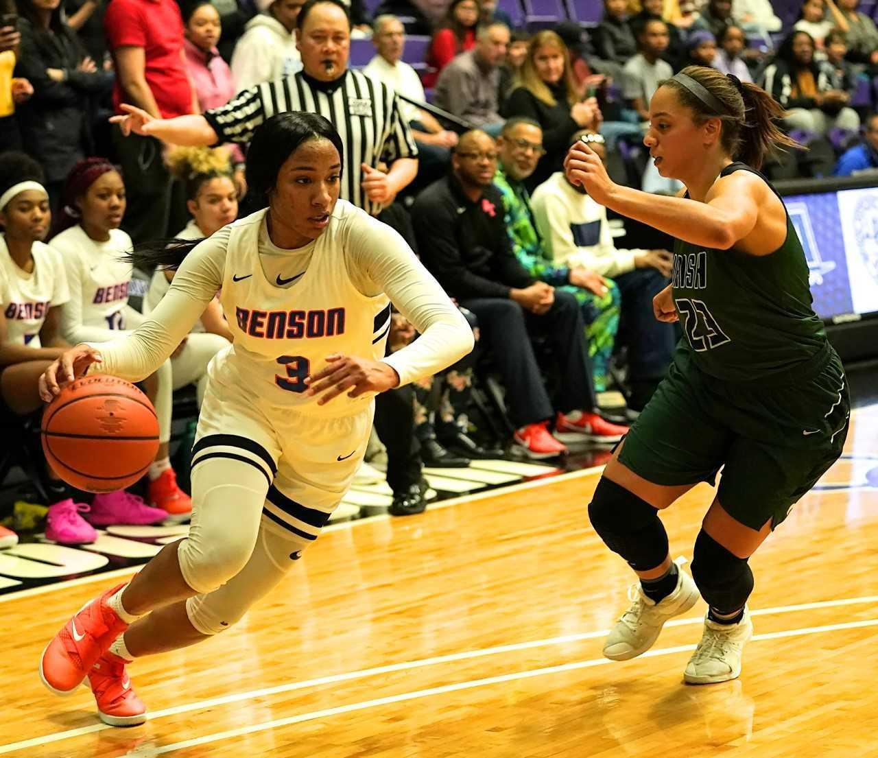 Benson's Ciera Ellington drives to the basket against Sheldon's Makayla Scurlock. (Photo by Jon Olson)