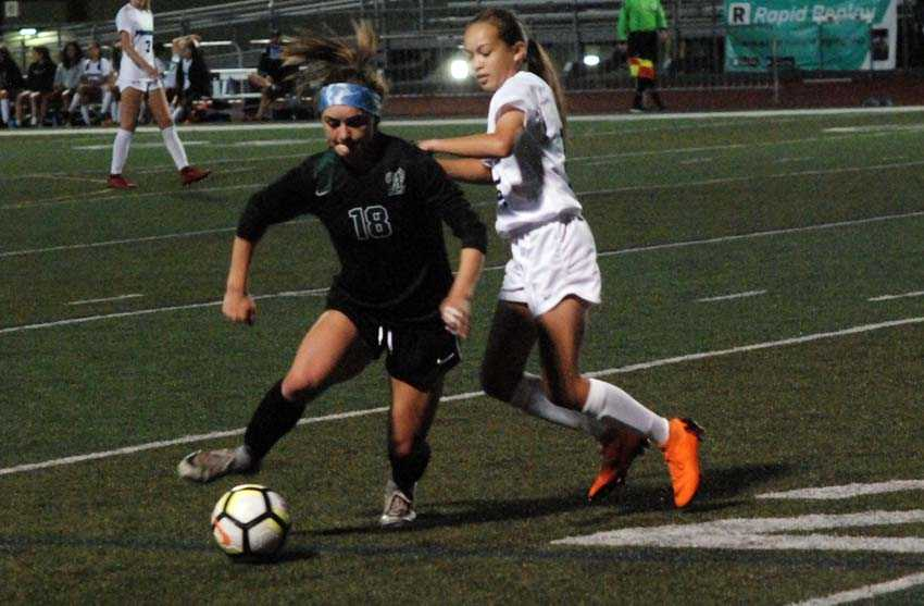 West Linn senior Rae Peters (18) scored three times in her debut at forward for the Lions on Tuesday
